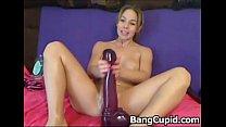 brunette beauty inserts huge dildo
